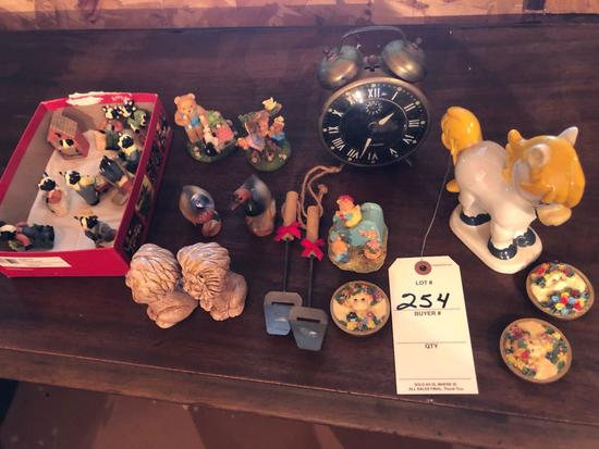 Vintage alarm clock, varied animal figurines, and more.