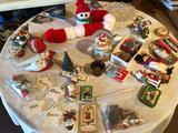 Various knick-knacks, Christmas decor, and glass plate.