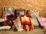 Various quilts, blankets, pillows, afghan, and more!