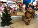 Wood double-sided, tiered plant stand; small Christmas tree, various wicker baskets, lamp (less