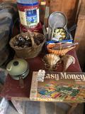 Wood table (41'' W x 29'' D x 24'' H), pots/pans/lids, basket of acorns, various tins, Easy Money