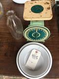Green metal Montgomery Wards 25 lb. scale, enamelware, and milk bottle.
