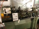 Grizzly 12'' x 37'' metal lathe, model DF-1237G, has 3 & 4 jaw chucks & faceplate - includes taper