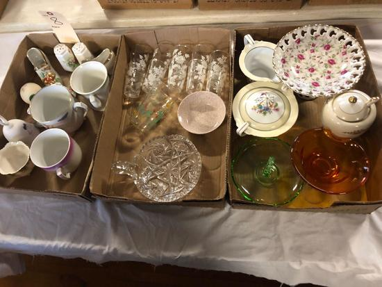 Misc. dishes, salt & pepper shakers, cream & sugar dishes, and Corning Ware.