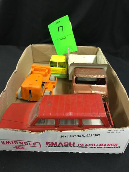 Assortment of Trucks and Toys
