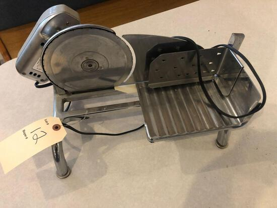 Rival 6'' countertop meat slicer.