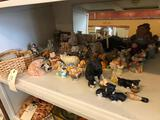 Various pig shaped figurines and heart shaped basket.