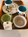 Various large coffee cups and small crock.