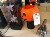 Halloween items and antique electric iron.