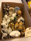 Assorted animal figurines and vases