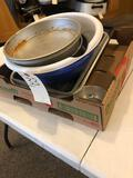 Cookie sheet, 9 x 13 cake pans, 9'' cake trays and plastic serving bowls.