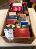 Various small Christmas decor items - some boxes are empty.