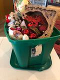 Large tote of Christmas decor and nativity set.