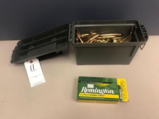 Plastic case approx. 2/3 full of 30-06 ammo.