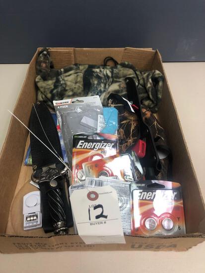 Gun supplies incl. camouflage hood. Rapala fillet knife, sword w/ sheath, rain coats, batteries, and
