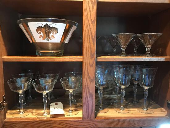 Assortment of various size stemmed glasses and glass punch bowl. NO SHIPPING!
