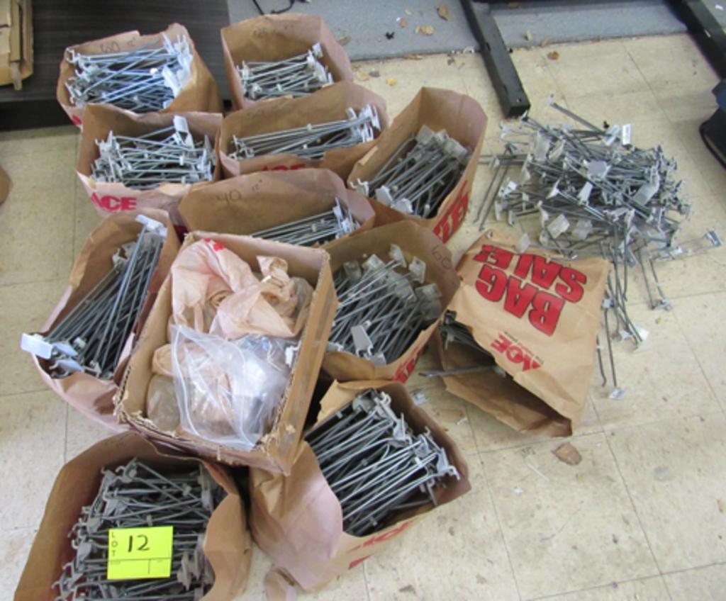 12 bags of peg board display hooks & a pile on floor