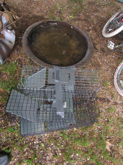 lot of 4 animal live traps and a fire pit