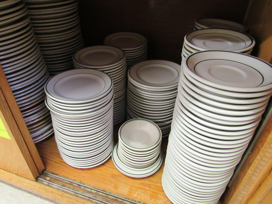 plates and saucers in cabinet