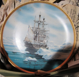 2 boxes of decorative plates