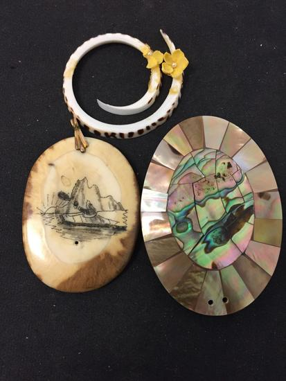 Lot of Three Various Size & Styled Pendants, One Abalone Inlaid, One Scrimshaw Engraved Bone & One