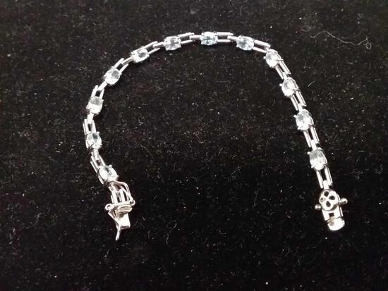 7.5 Inch Sterling Silver & Blue Topaz Tennis Bracelet