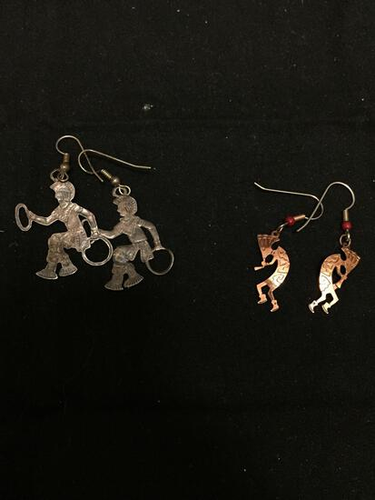 Lot of Two Silver and Rose Tone Alloy Pairs of Kokopelli Design Drop Earrings
