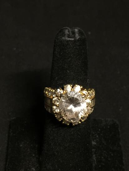 Oval Faceted 12x10mm CZ Center w/ Round CZ Halo & Baguette Accented Shoulders Gold-Tone Signed