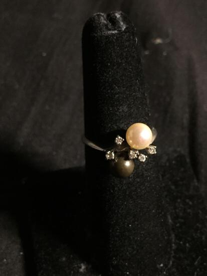 Two Round 5.5mm White & Black Pearls Featured w/ Round CZ Accents Stamped 14Kt MCP Ring Band