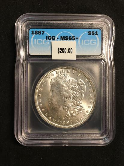 1887 United States Morgan Silver Dollar - ICG Graded MS 65+
