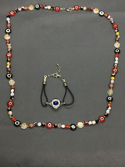 Lot of Two Evil Eye Themed Fashion Jewelry, 28in Long Hand-Strung Beaded Necklace & 7in Long Leather