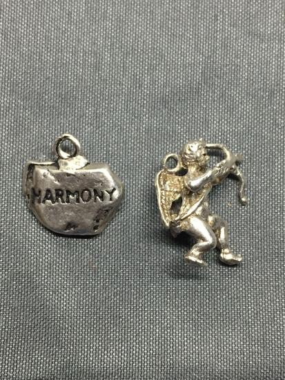 Lot of Two Sterling Silver Charms, One Cupid & One Harmony Rock