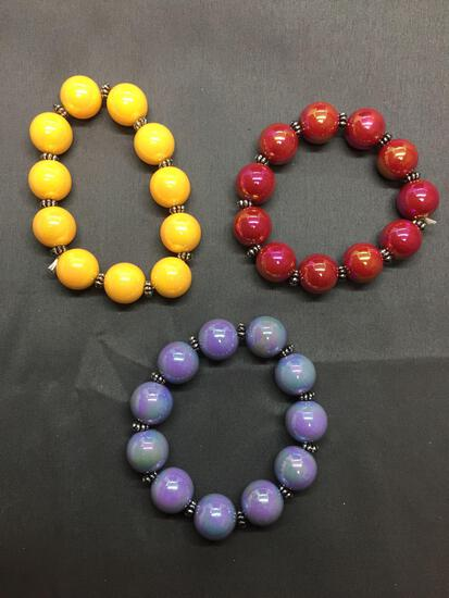 Lot of Three Iridescent Bead 8in Stretchable Fashion Bracelets, One Lavender, One Red & One Yellow