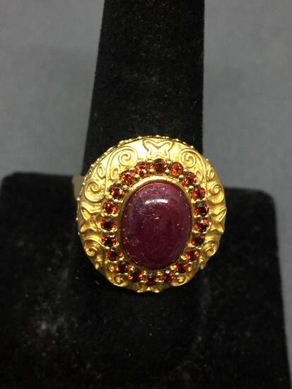 Oval 12x9mm Ruby Cabochon Center w/ Round Garnet Accented Halo Filigree Decorated Gold-Tone Sterling