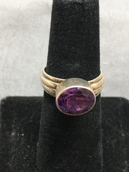 Horizontal Bezel Oval Faceted 10x8mm Amethyst Center Groove Detailed Sterling Silver Ring Band