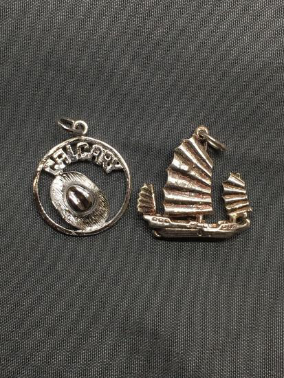 Lot of Two Sterling Silver Charms, One Chinese Themed Fishing Boat & One City of Calgary