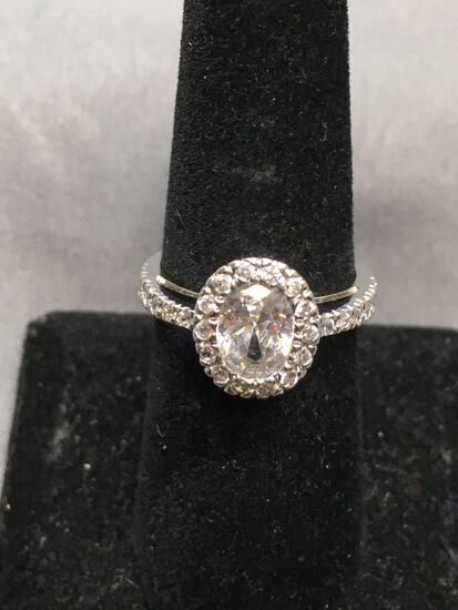 Oval Faceted 8x6mm CZ Center w/ Round CZ Accented Halo & Shoulders High Polished Sterling Silver