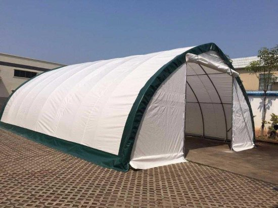 20 FT x 20 FT x 12FT Peak Ceiling Storage Shelton C/W: Commercial fabric, roll up door