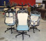 7 Turquoise/Tan Rolling Office Chairs
