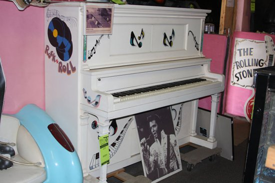 White Piano Signed by Billy Joel