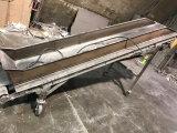 8 foot long conveyor belt, on conveyor belt,  with 3 phase motor
