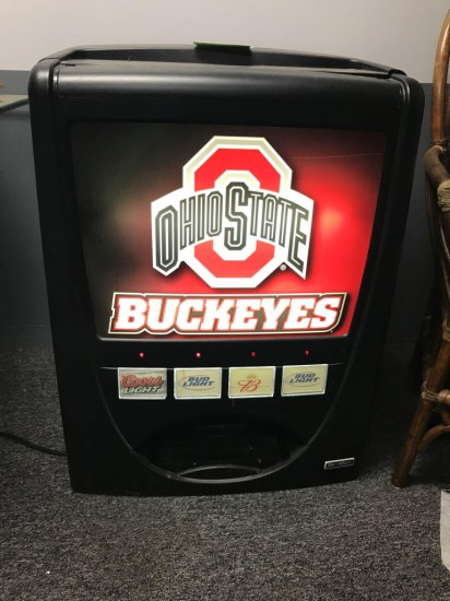 """Tabletop """"free vend"""" beer machine 35 inches tall, powers on"""