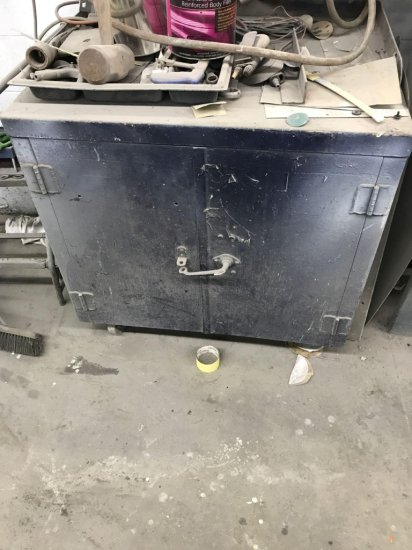 Metal Cabinet on casters with storage underneath
