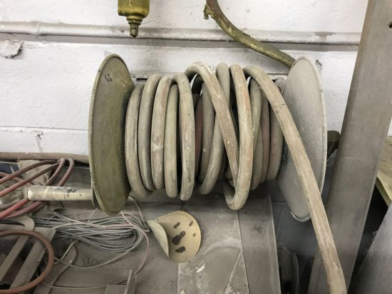 Wall mounted hose reel, with approx 25-50 foot of hose