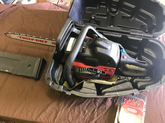 Troy-Bilt 18 inch chainsaw with carry case, has compression