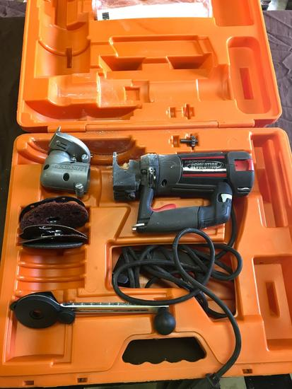 RotoZip Revolution Spiral Saw with case, and some accessories, powers on