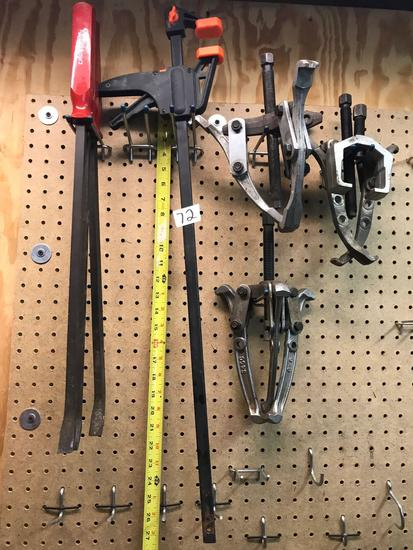 Lot includes, pry bars, clamp, and pullers