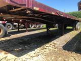 1981 Fruehauf 35 foot flatbed tubing trailer w/ rolling tail board