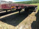 1977 Strickland 30 ft flatbed tubing trailer w/ rolling tail board