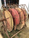 4 slot discharge hose reel with hoses.